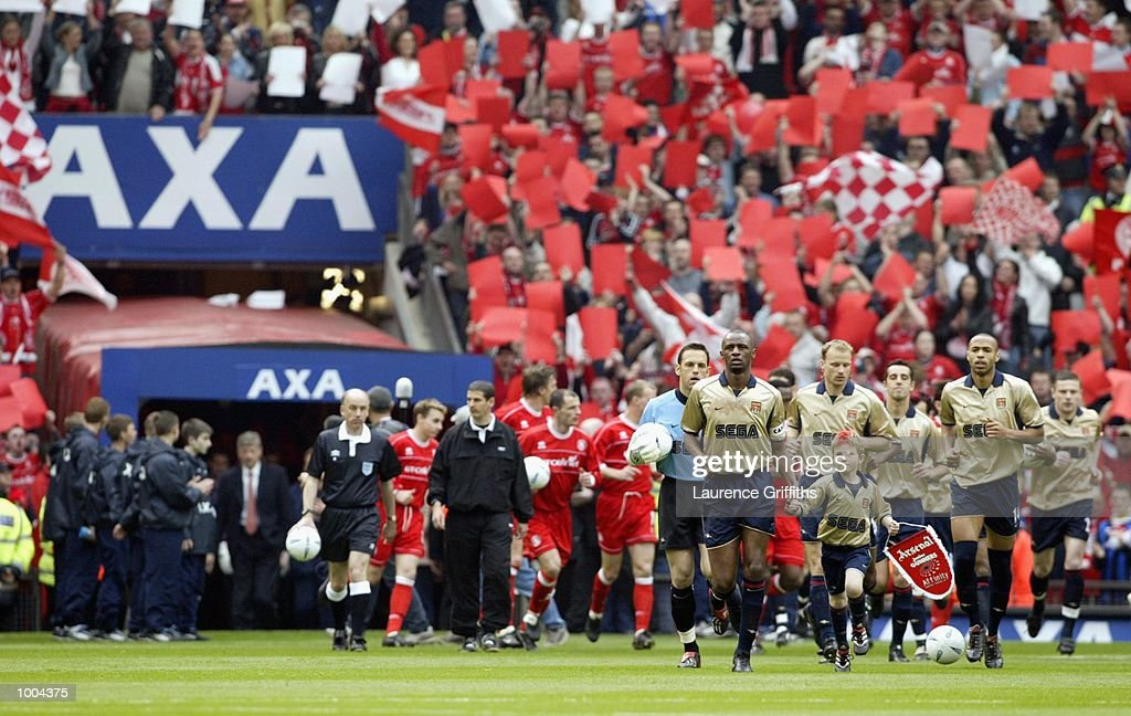 Arsenal and Middlesbrough enter the stadium during the AXA sponsored FA Cup semi final tie between Middlesbrough v Arsenal at Old Trafford Stadium, Manchester. DIGITAL IMAGE. Mandatory Credit: Laurence Griffiths/Getty Images
