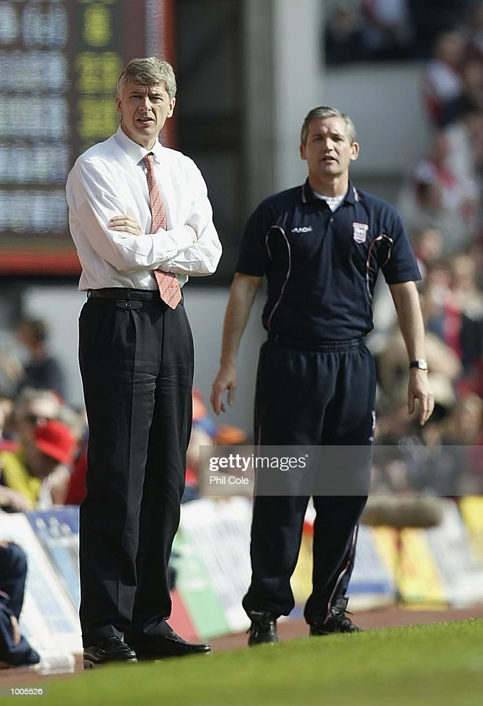 Arsenal manager Arsene Wenger and (Right) Ipswich Town manager George Burley during the FA Barclaycard Premiership match between Arsenal and Ipswich Town at Highbury, London. DIGITAL IMAGE Mandatory Credit: Phil Cole/Getty Images