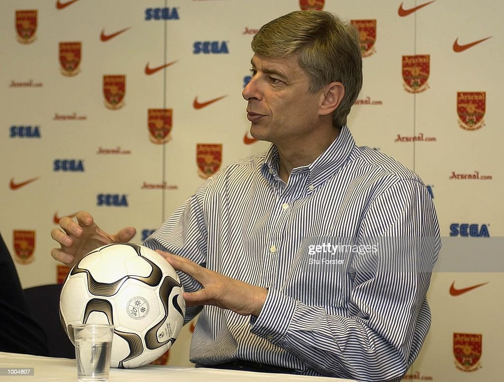 Arsenal Manager Arsene Wenger discusses the new Nike Geo Merlin Vapor Ball at a Press Day to launch the Nike World Cup Range at Arsenal's training ground at Colney Hatch, London. DIGITAL IMAGE. Mandatory Credit: Stu Forster/Getty Images