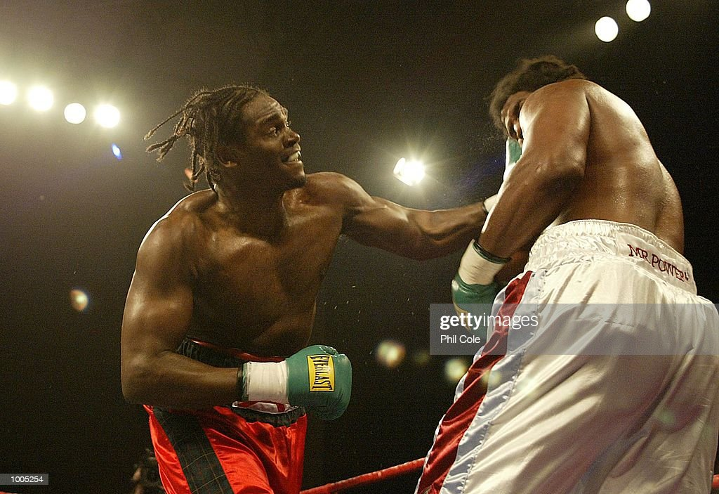 Audley Harrison of Great Britain punches Julius Long of the USA during the Heavyweight fight at the Wembley Conference Centre, London. DIGITAL IMAGE. Mandatory Credit: Phil Cole/Getty Images