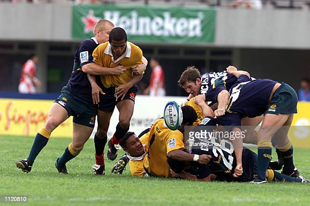 Australia and Malaysia fights for the ball during the Singapore Sevens between Australia and Malaysia during the IRB World Rugby Sevens Series held...