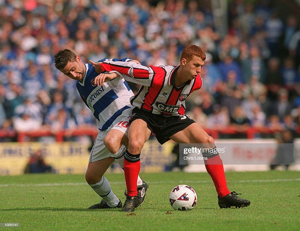 Ben Burgess of Brentford and Nicky Forster of Reading battle for the ball during the Nationwide Division Two match between Brentford and Reading at Griffin Park, Brentford, London. Mandatory Credit: Chris Lobina/Getty Images