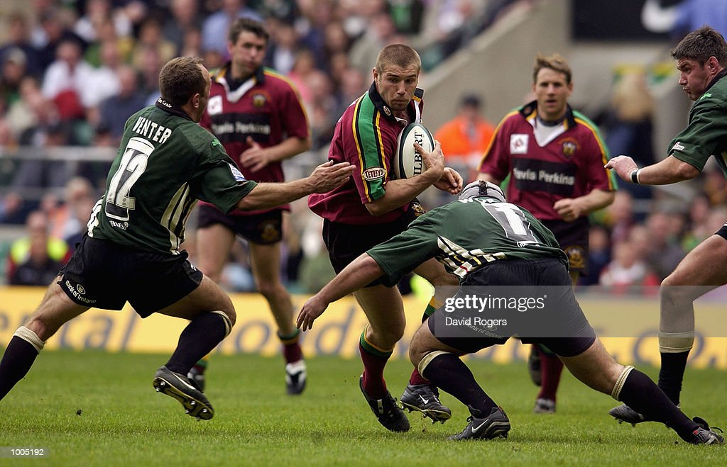 Ben Cohen of Northampton trys to break through the challenge of Brendan Venter and Michael Worsley of London Irish during the Powergen Cup Final between Northampton Saints and London Irish at Twickenham, London. DIGITAL IMAGE. Mandatory Credit: Dave Rogers/Getty Images