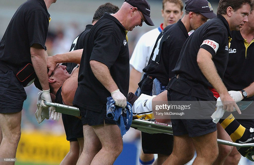 Ben Holland #16 for the Tigers stretchered off with an injured knee during the AFL match between the Fremantle Dockers and the Richmond Tigers, played at the Subiaco Oval, Western Australia. DIGITAL IMAGE Mandatory Credit: Tony McDonough/Getty Images