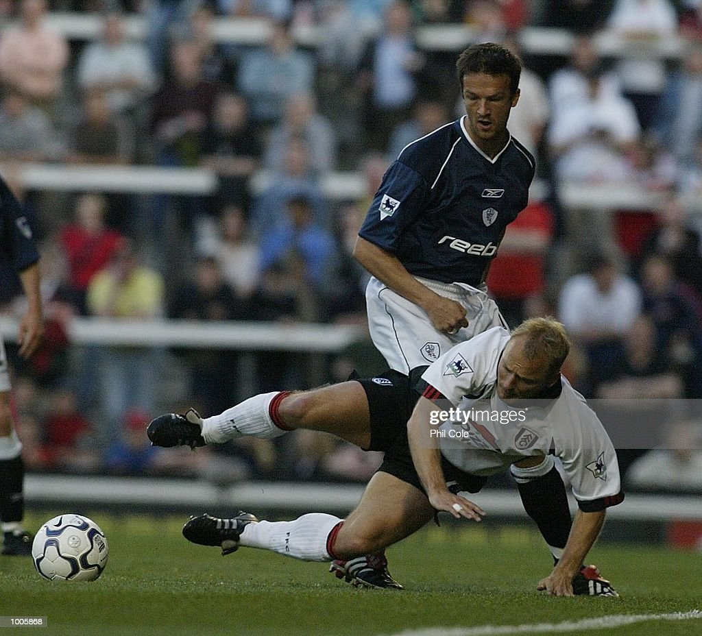Bjarne Goldbaek of Fulham is tackled by Fredi Bobic of Bolton Wanderers during the FA Barclaycard Premiership match between Fulham and Bolton Wanderers at Craven Cottage, London. DIGITAL IMAGE Mandatory Credit: Phil Cole/Getty Images