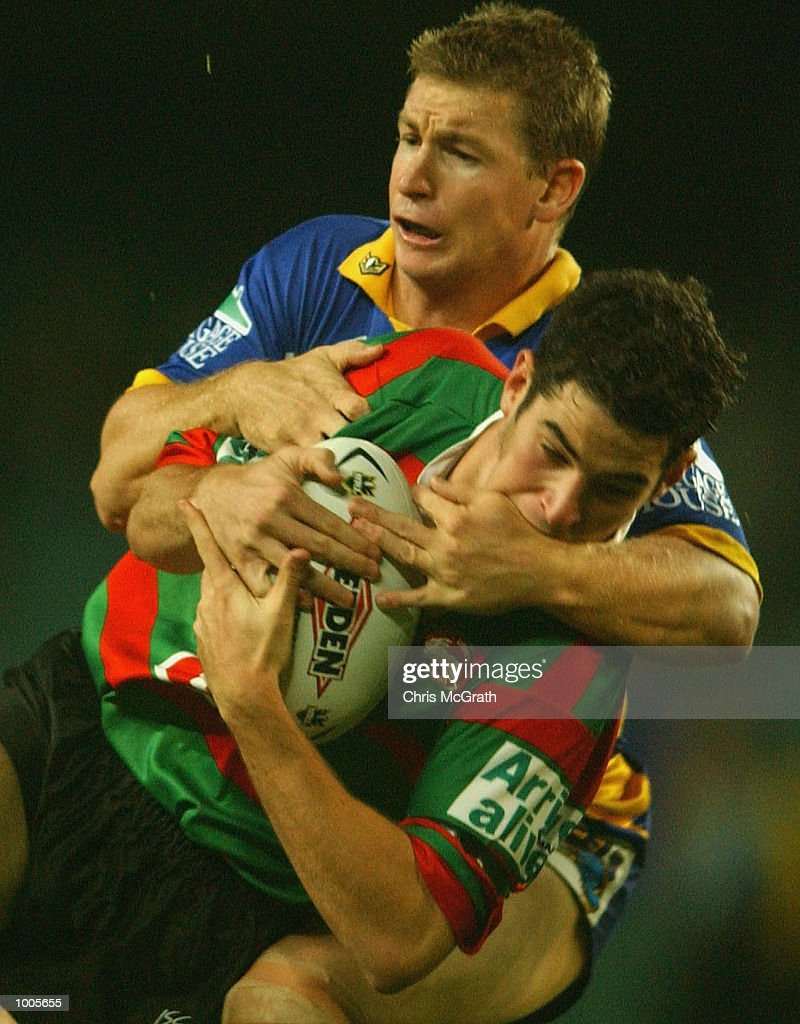 Blaine Stanley #7 of the Rabbitohs is tackled by Adam Dykes #6 of the Eels during the Round 6 NRL match between the South Sydney Rabbitohs and the Parramatta Eels held at Aussie Stadium, Sydney, Australia. DIGITAL IMAGE. Mandatory Credit: Chris McGrath/Getty Images
