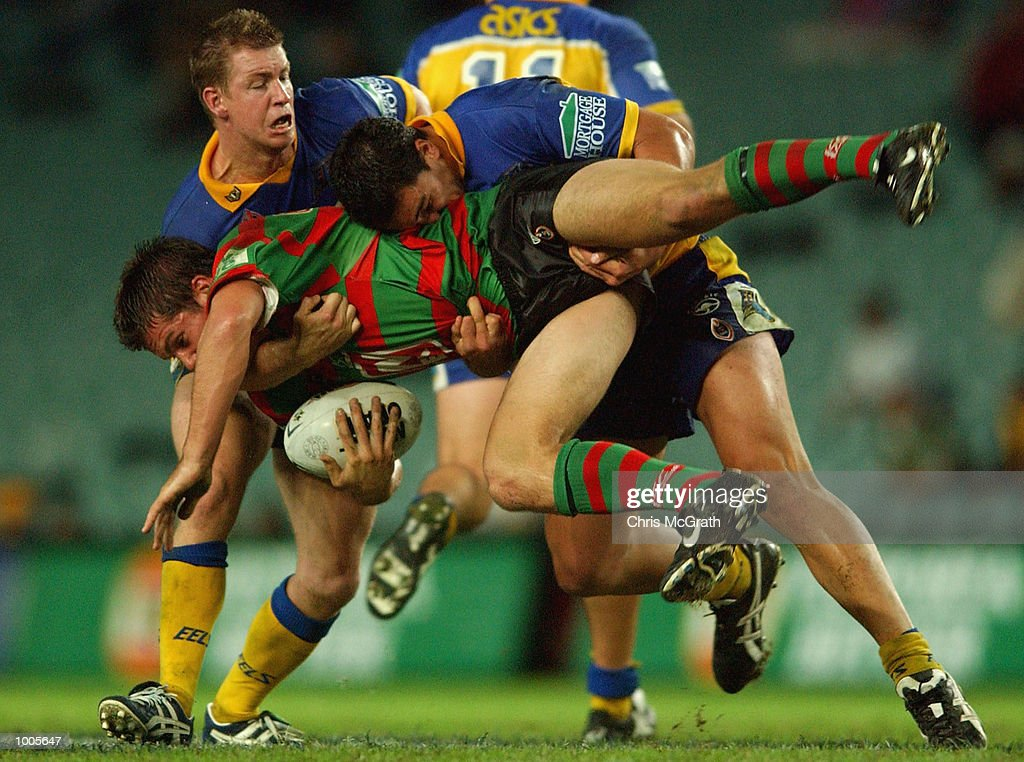 Brett Grose #5 of the Rabbitohs is lifted by the Eels defence during the Round 6 NRL match between the South Sydney Rabbitohs and the Parramatta Eels held at Aussie Stadium, Sydney, Australia. DIGITAL IMAGE. Mandatory Credit: Chris McGrath/Getty Images