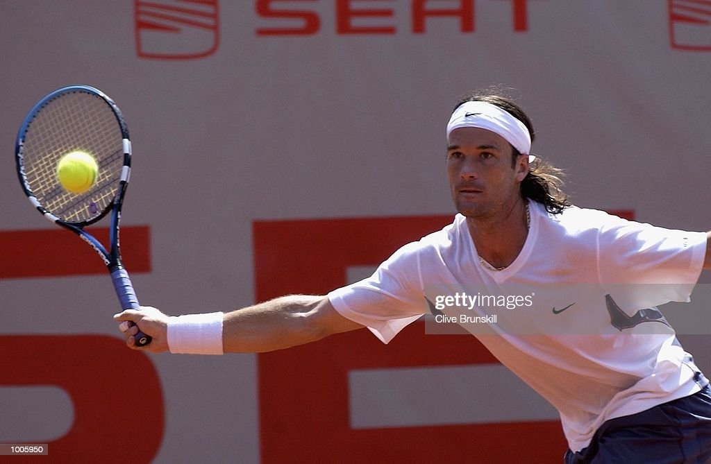 Carlos Moya of Spain stetches for a forehand during his second round match against Andrea Gaudenzi of Italy during the Open Seat Godo 2002 held in Barcelona, Spain. DIGITAL IMAGE Mandatory Credit: Clive Brunskill/Getty Images