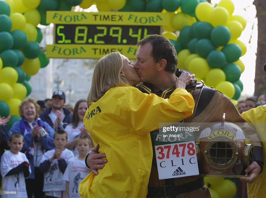 Charity runner Lloyd Scott is congratulated by Paul Radcliffe with a kiss as he goes past the Embankment during The 2002 Flora London Marathon. DIGITAL IMAGE Mandatory Credit: Ian Walton/Getty Images