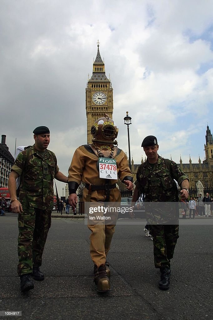 Charity runner Lloyd Scott on his way past Big Ben during The 2002 Flora London Marathon. DIGITAL IMAGE Mandatory Credit: Ian Walton/Getty Images