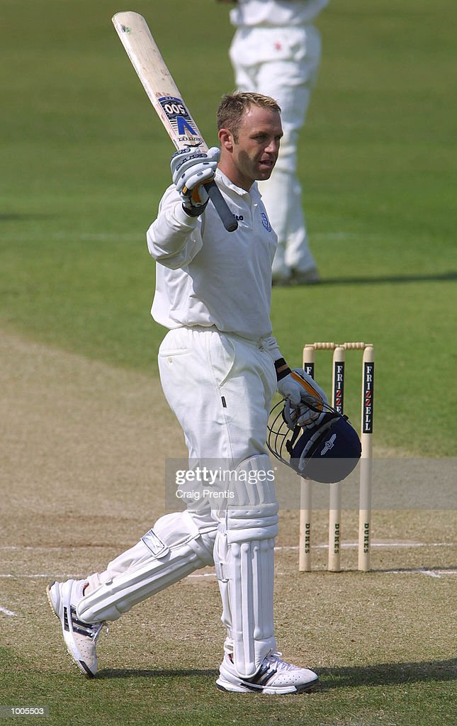 Chris Adams of Sussex celebrates scoring a century on the third day of the Frizzell County Championship match between Surrey and Sussex at the Oval, London. DIGITAL IMAGE. Mandatory Credit: Craig Prentis/Getty Images