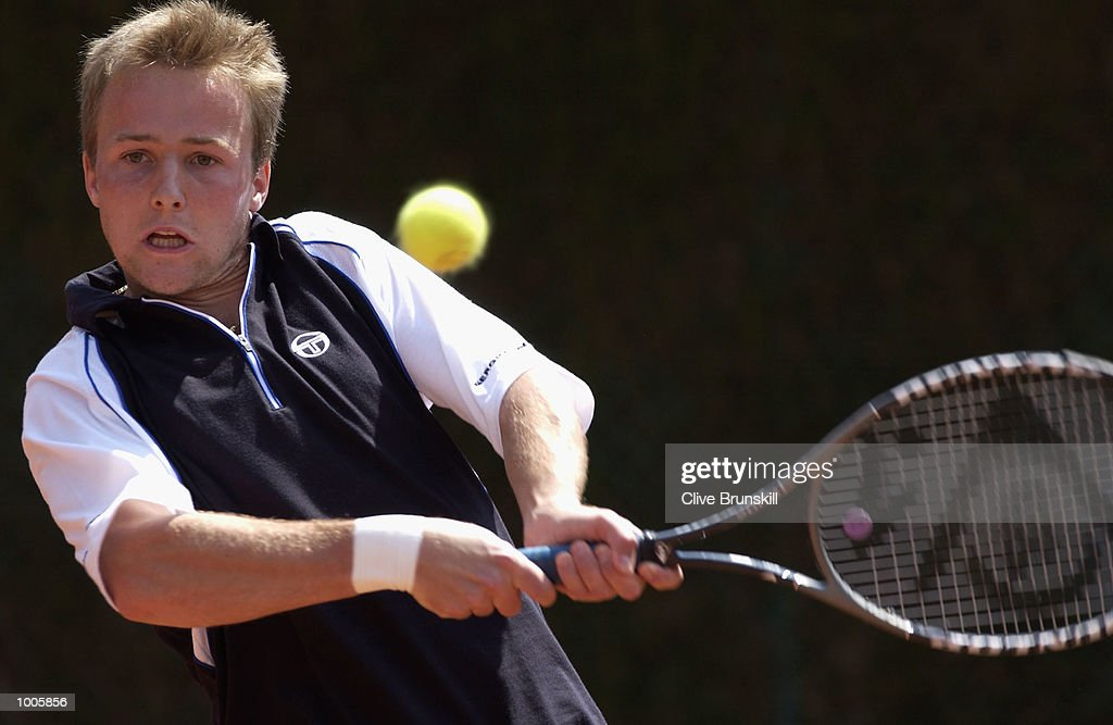 Christophe Rochus of Belgium plays a backhand in his first round match against Augustin Calleri of Argentina during the Open Seat Godo 2002 held in Barcelona, Spain. DIGITAL IMAGE Mandatory Credit: Clive Brunskill/Getty Images