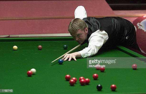 Dave Harold of England in action during the first round match against Anthony Hamilton during the Embassy World Snooker Championships at the Crucible...