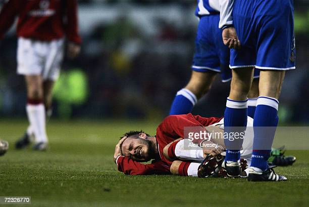 David Beckham of Manchester United falls to the floor in agony after picking up a serious injury during the UEFA Champions League quarter final...
