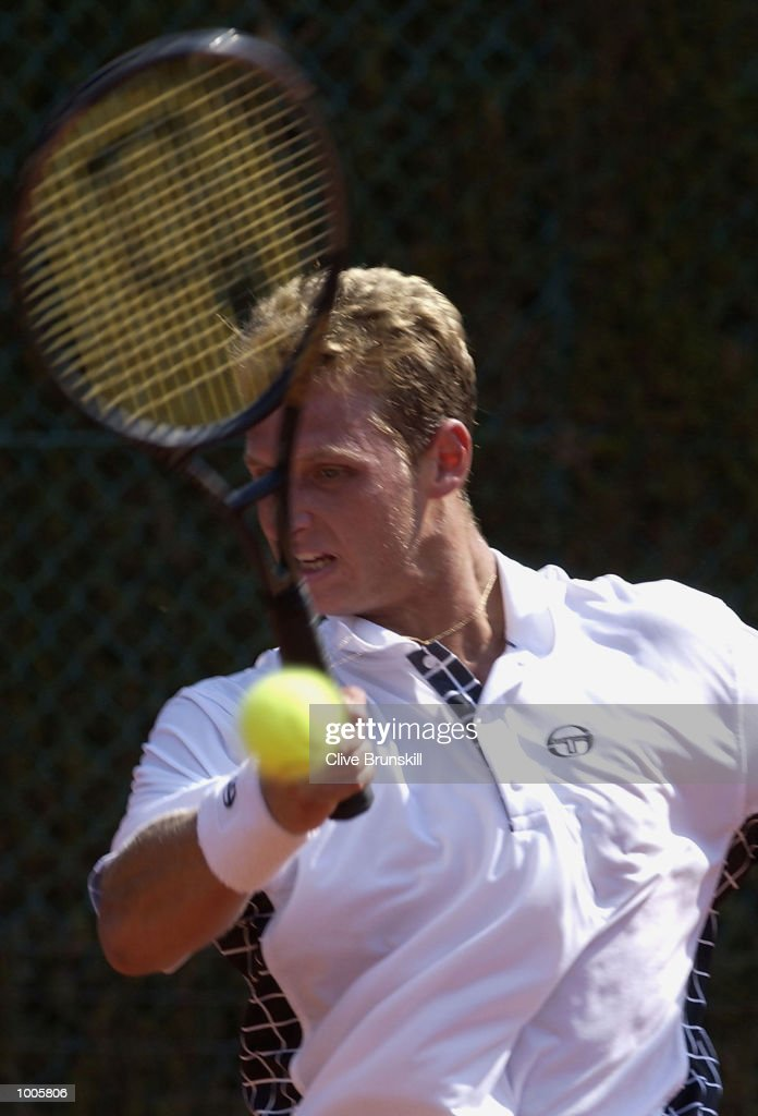 David Nalbandian of Argentina plays a forehand during his first round match against Adrian Voinea of Romainia during the Open Seat Godo held in Barcelona, Spain. DIGITAL IMAGE Mandatory Credit: Clive Brunskill/Getty Images