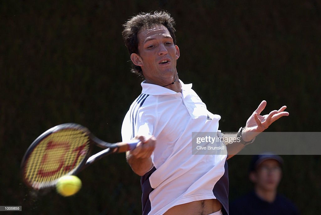 David Sanchez of Spain plays a forehand in his first round match against Mariano Zabaleta of Argentina during the Open Seat Godo 2002 held in Barcelona, Spain. DIGITAL IMAGE Mandatory Credit: Clive Brunskill/Getty Images