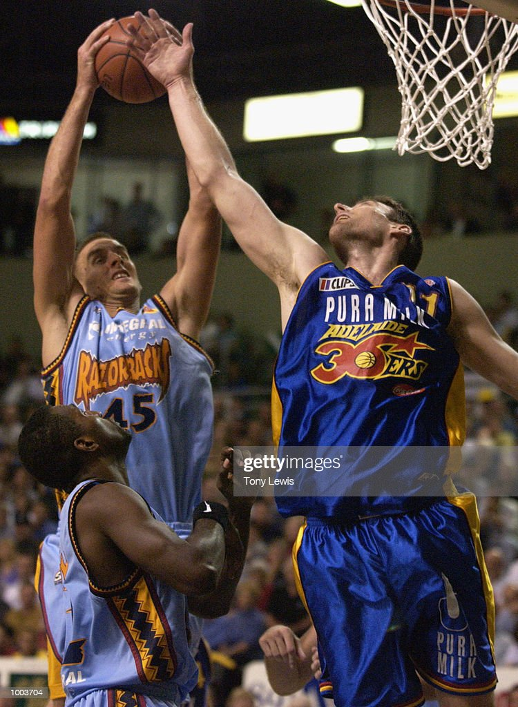 David Stiff #11 for the 36ers tries to block a shot from Simon Dwight # 45 the Razorbacks in game 1 of the NBL grand finals between the Adelaide 36ers and the West Sydney Razorbacks played at Clipsal Powerhouse in Adelaide, Australia. The36ers (106) defeated the Razorbacks (97). Digital Image. Mandatory Credit: Tony Lewis/Getty Images