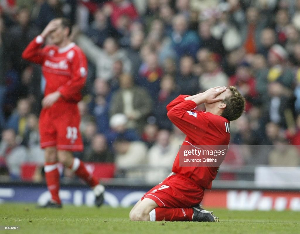 Dean Windass and Alan Johnstone of Boro look dejected during the AXA sponsored FA Cup semi final tie between Middlesbrough v Arsenal at Old Trafford Stadium, Manchester. DIGITAL IMAGE. Mandatory Credit: Laurence Griffiths/Getty Images