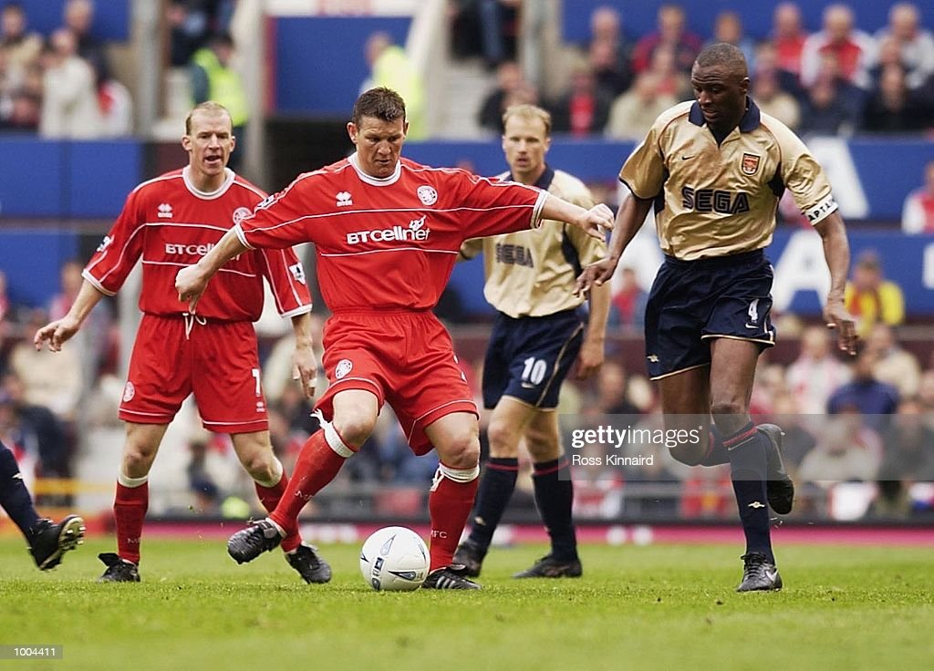 Dean Windass of Middlesbrough holds off Patrick Vieira of Arsenal during the AXA FA Cup Semi Final between Arsenal and Middlesbrough at Old Trafford, Manchester. DIGITAL IMAGE. Mandatory Credit: Ross Kinnaird/Getty Images