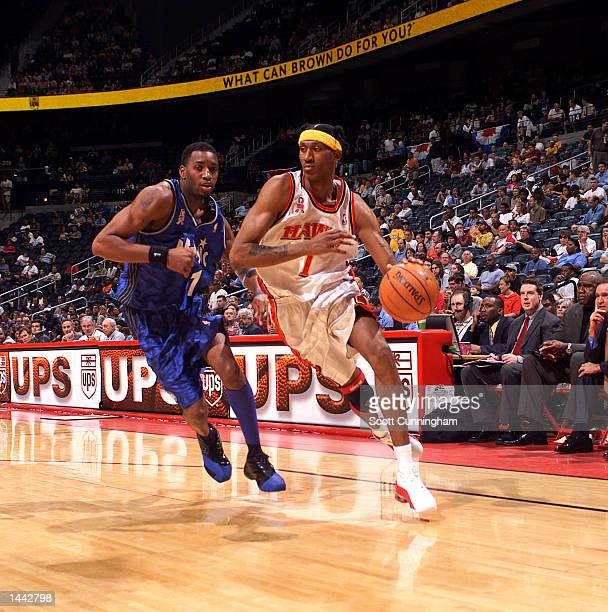 DerMarr Johnson of the Atlanta Hawks goes to the basket against Tracy McGrady of the Orlando Magic at Philips Arena in Atlanta Georgia Digital Image...