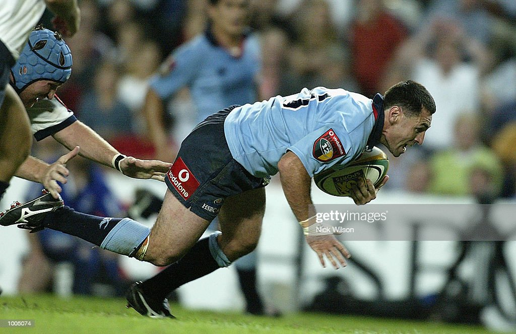 Duncan McRae of the Waratahs dives in for a try during the Round 9 Super 12 match between the the ACT Brumbies and the New South Wales Waratahs being played at Aussie Stadium, Sydney, Australia Mandatory Credit: Nick Wilson/Getty Images