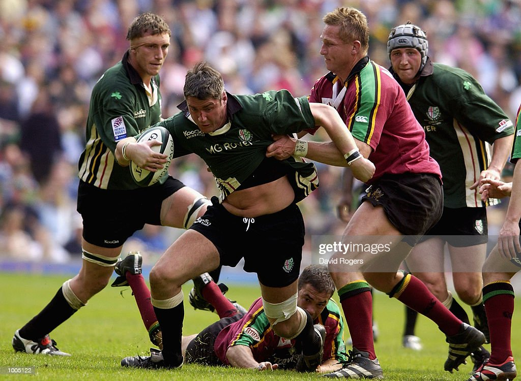 Eddie Halvey of London Irish breaks the tackle of Johan Ackermann of Northampton during the Powergen Cup Final between Nothampton Saints and London Irish at Twickenham, London. DIGITAL IMAGE. Mandatory Credit: Dave Rogers/Getty Images