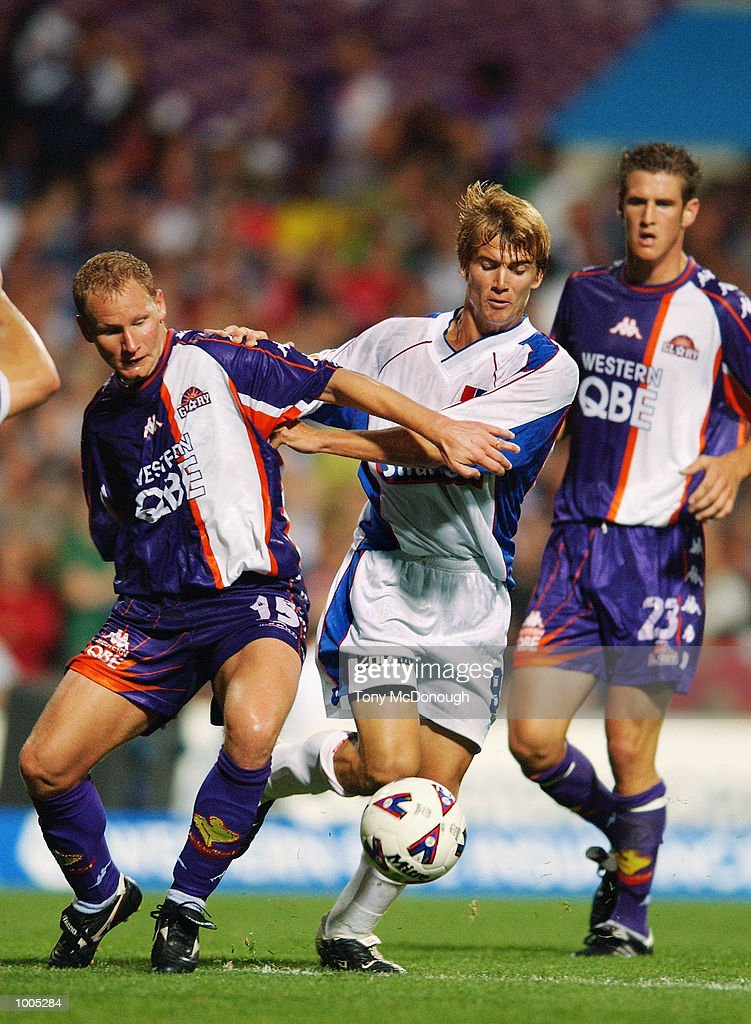 Edgar Adlrighi Jnr #15 for the Glory contests the ball against Joel Griffiths #9 for Newcastle during the major semi-final first leg between Perth Glory v Newcastle United, played at the Subiaco Oval. DIGITAL IMAGE Mandatory Credit: TonyMcDonough/Getty Images
