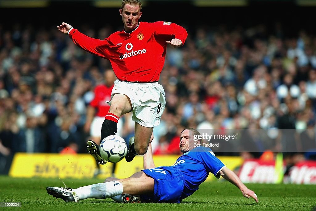 Emmanual Petit of Chelsea tries to tackle Nicky Butt of Manchester United during the FA Barclaycard Premiership match between Chelsea and Manchester United at Stamford Bridge, London. DIGITAL IMAGE Mandatory Credit: Ben Radford/Getty Images