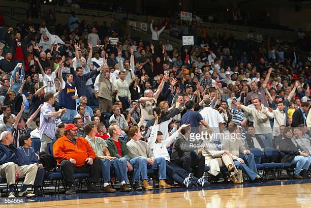 Fans clamor for freebies during the NBA game between the Portland Trail Blazers and the Golden State Warriors at The Arena in Oakland in Oakland...