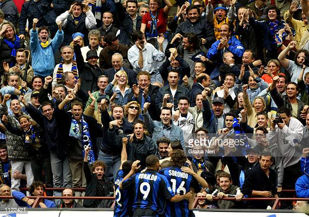 Fans of Inter Milan celebrate their team scoring during the Serie A match between Inter Milan and Piacenza played at the 'Giuseppe Meazza'Stadium San...