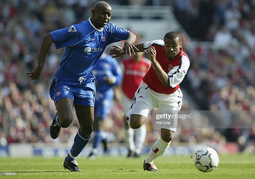 Finidi George of Ipswich Town tries to tackle Ashley Cole of Arsenal during the FA Barclaycard Premiership match between Arsenal and Ipswich Town at Highbury, London. DIGITAL IMAGE Mandatory Credit: Phil Cole/Getty Images