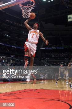 Forward DerMarr Johnson of the Atlanta Hawks dunks the ball during the NBA game against the Indiana Pacers at Philips Arena in Atlanta Georgia The...