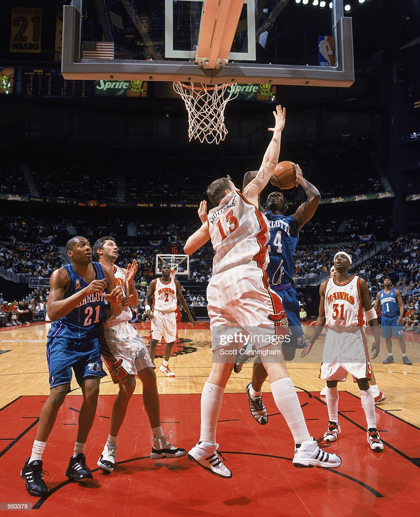 Jamal Mashburn of the Charlotte Hornets shoots