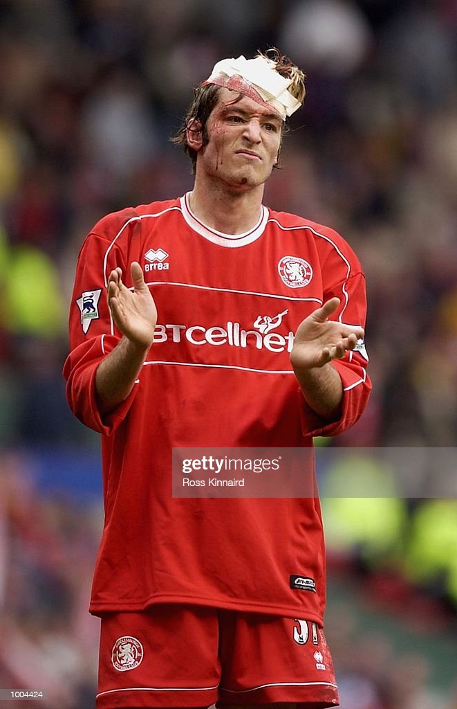 Franck Queudrue of Middlesbrough leaves the field after the AXA FA Cup Semi Final between Arsenal and Middlesbrough at Old Trafford, Manchester. DIGITAL IMAGE. Mandatory Credit: Ross Kinnaird/Getty Images