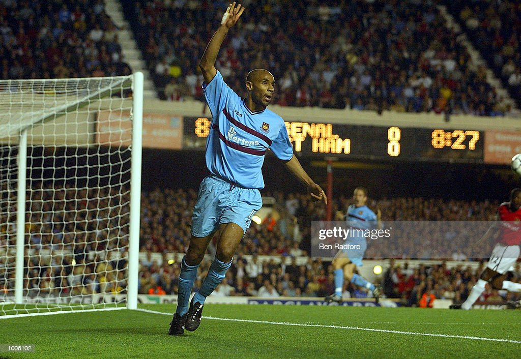 Frederic Kanoute of West Ham celebrates what he thinks is a goal as Ashley Cole of Arsenal clears the ball off the line during the FA Barclaycard Premiership match between Arsenal and West Ham United at Highbury, London. DIGITAL IMAGE Mandatory Credit: Ben Radford/Getty Images
