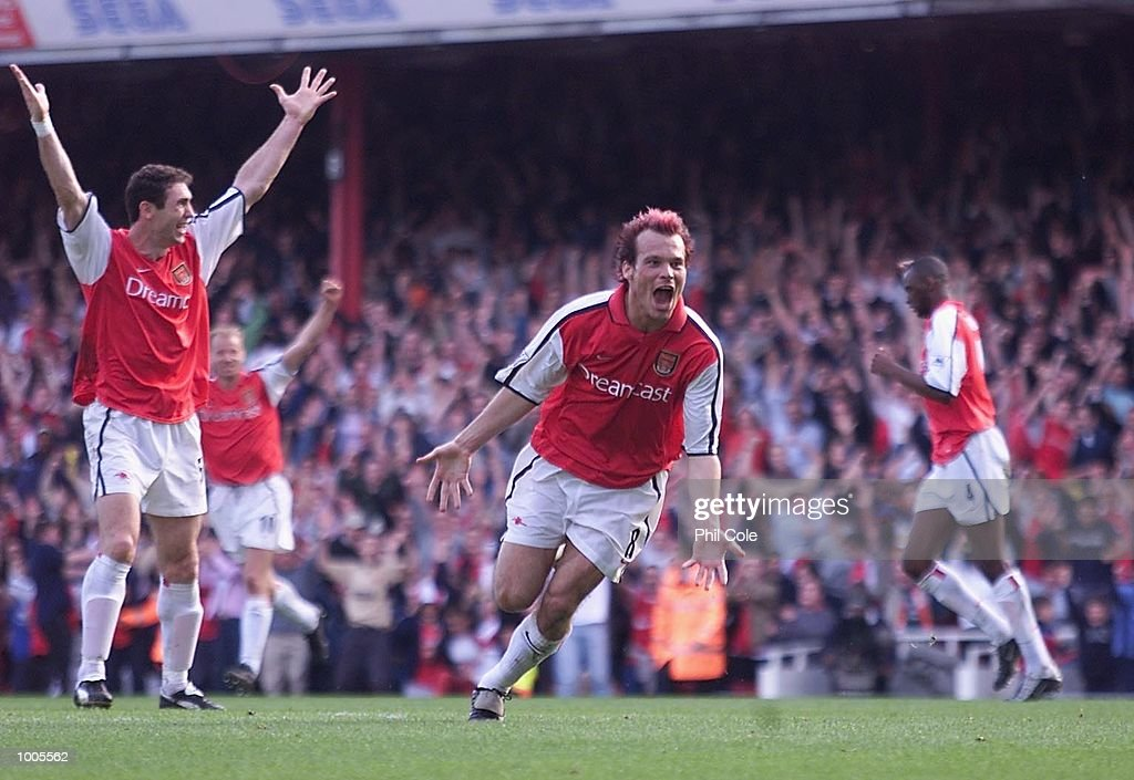 Fredrik Ljungberg of Arsenal celebrates scoring the first goal during the FA Barclaycard Premiership match between Arsenal and Ipswich Town at Highbury, London. DIGITAL IMAGE Mandatory Credit: Phil Cole/Getty Images