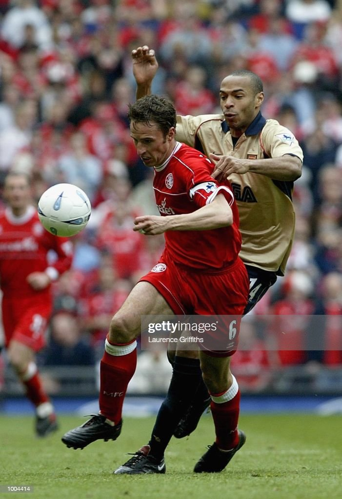 Gareth Southgate of Boro holds off Thierry Henry of Arsenal during the AXA sponsored FA Cup semi final tie between Middlesbrough v Arsenal at Old Trafford Stadium, Manchester. DIGITAL IMAGE. Mandatory Credit: Laurence Griffiths/Getty Images