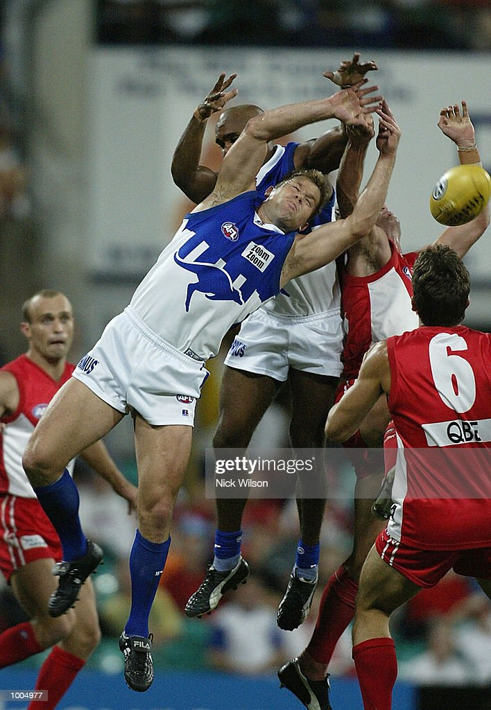 Glenn Archer#11 of the Kangaroos in the front of a pack during the Round 4 AFL Match between the Sydney Swans and the Kangaroos being played at the Sydney Cricket Ground, Sydney, Australia. Mandatory Credit: Nick Wilson/Getty Images