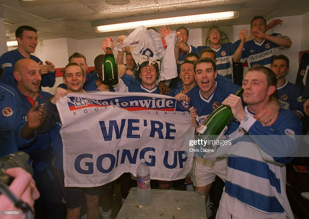 Goal-scorer Jamie Cureton (right) drinks champagne to celebrate promotion after the Nationwide Division Two match between Brentford and Reading at Griffin Park, Brentford, London. Mandatory Credit: Chris Lobina/Getty Images