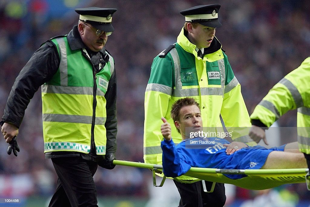 Graeme Le Saux of Chelsea gives the fans the thumbs up as they cheer him as he is carried off injured during the Axa FA Cup Semi Final match between Chelsea and Fulham at Villa Park, Birmingham. DIGITAL IMAGE. Mandatory Credit: Ben Radford/Getty Images