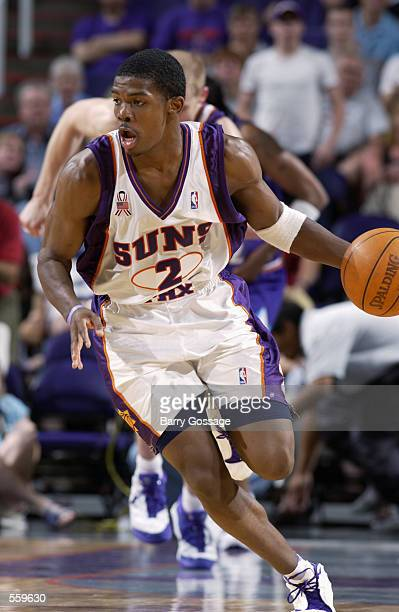 Guard Joe Johnson of the Phoenix Suns dribbles the ball during the NBA game against the Utah Jazz at America West Arena in Phoenix Arizona The Jazz...