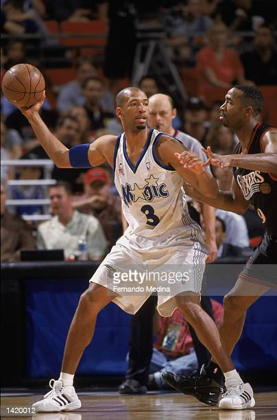 Guard Monty Williams of the Orlando Magic holds the ball as forward Derrick McKey of the Philadelphia 76ers plays defense during the NBA game at the...