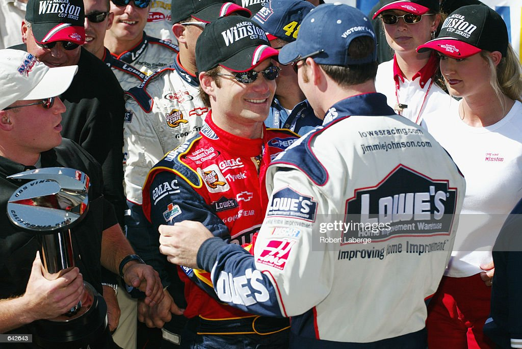 Hendrick Motorsports driver Jimmie Johnson is congratulated by coowner Jeff Gordon after winning the NASCAR Winston Cup Series NAPA Auto Parts 500 at...