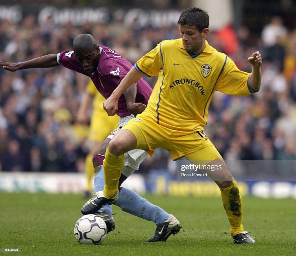Ian Taylor of Villa battles for the ball with Eric Bakke of Leeds during the FA Barclaycard Premiership match between Aston Villa and Leeds United at Villa Park, Birmingham. DIGITAL IMAGE. Mandatory Credit: Ross Kinnaird/Getty Images