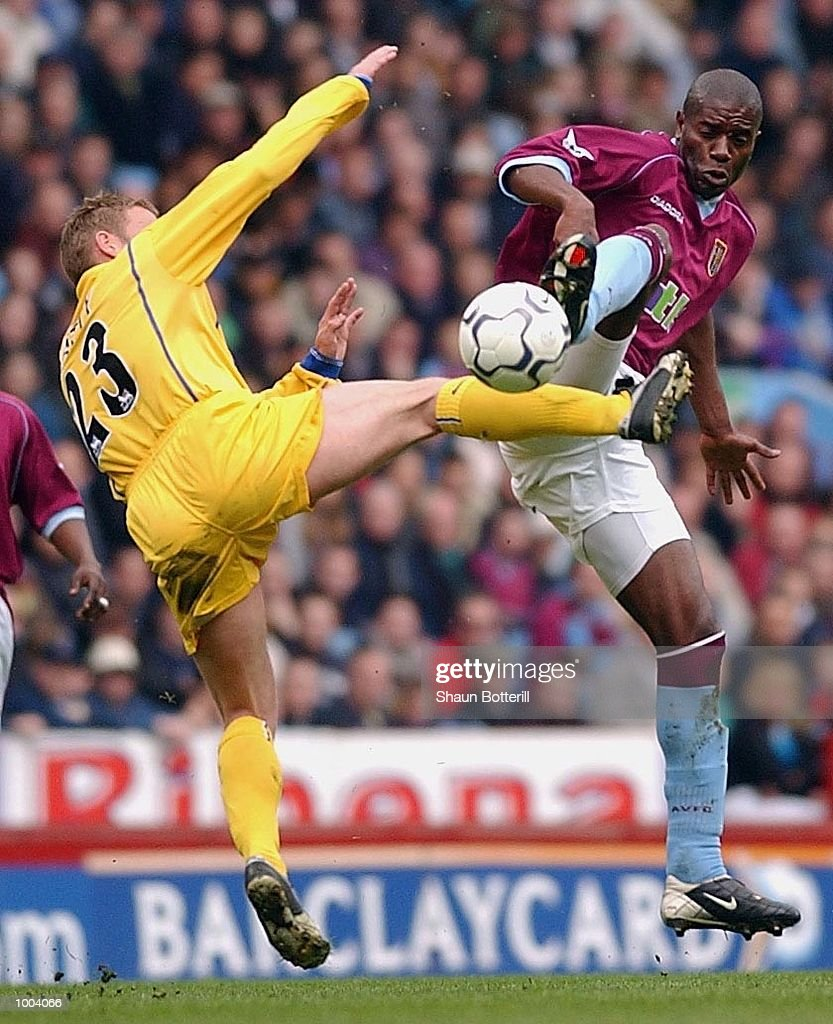 Ian Taylor of Villa challenges David Batty of Leeds during the FA Barclaycard Premiership match between Aston Villa and Leeds United at Villa Park, Birmingham. DIGITAL IMAGE. Mandatory Credit: Shaun Botterill/Getty Images