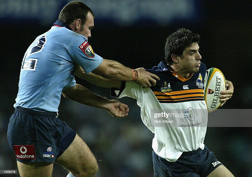 James Holbeck of the Brumbies holds off Nathan Grey of the Waratahs during the Round 9 Super 12 match between the the ACT Brumbies and the New South Wales Waratahs being played at Aussie Stadium, Sydney, Australia Mandatory Credit: Nick Wilson/Getty Images