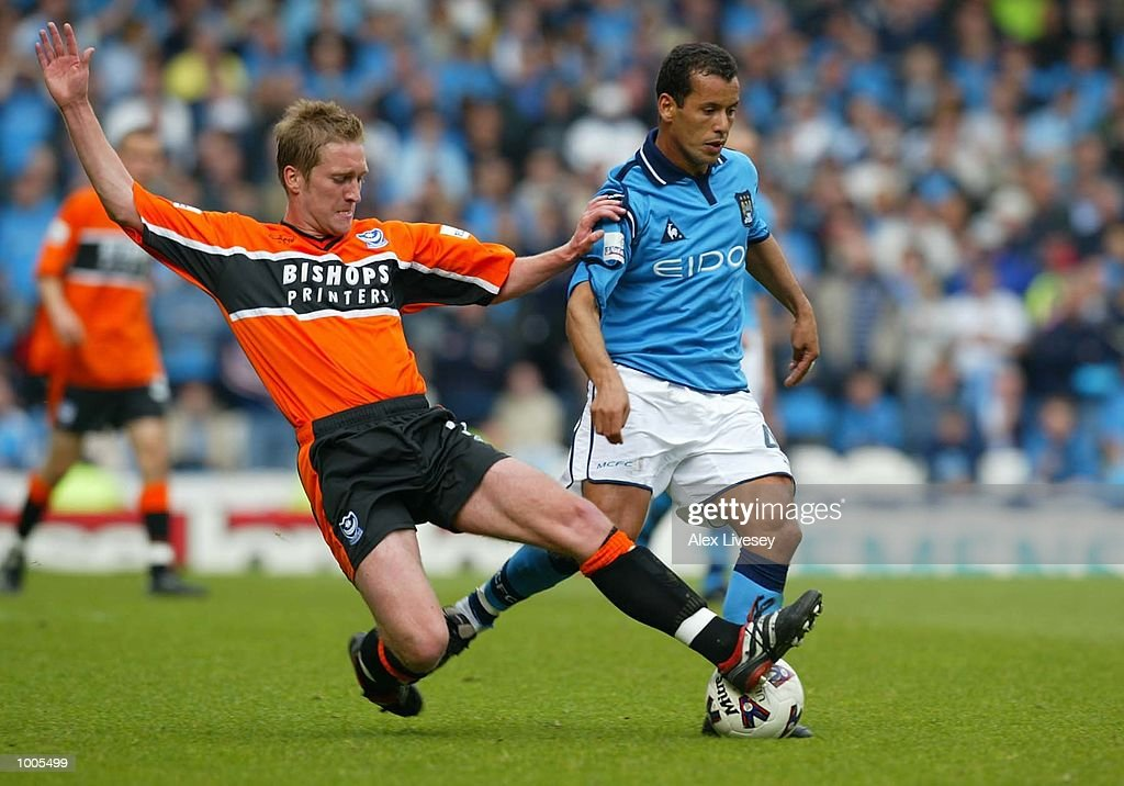 Jamie Vincent of Portsmouth tackles Ali Benarbia of Man City during the Nationwide first division game between Manchester City and Portsmouth at Maine Road, Manchester. DIGITAL IMAGE. Mandatory Credit: Alex Livesey/Getty Images