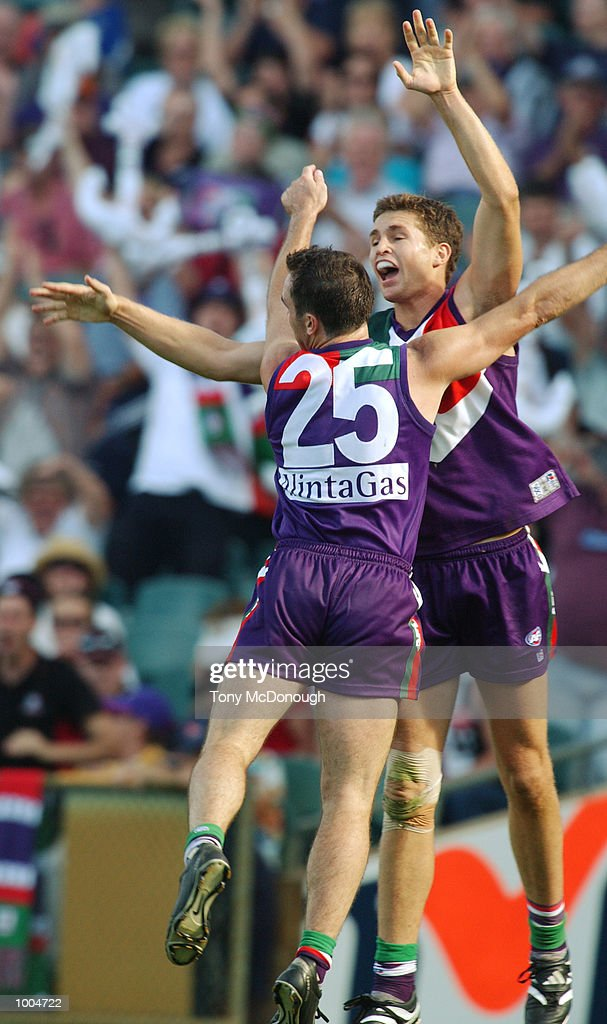 Jason Norrish #25 and Justin Longmuir #20 for Fremantle celebrate their win in the round two AFL match between the Fremantle Dockers and St Kilda Saints played at Subiaco Oval in Western Australia.Mandatory Credit: Tony McDonough/Getty Images