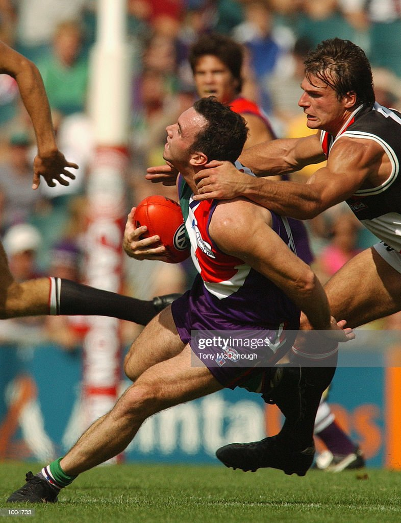 Jason Norrish #25 for Fremantle is caught by Aaron Hamill #2 for St Kilda during the round two AFL match between the Fremantle Dockers and St Kilda Saints played at Subiaco Oval in Western Australia.Mandatory Credit: Tony McDonough/Getty Images