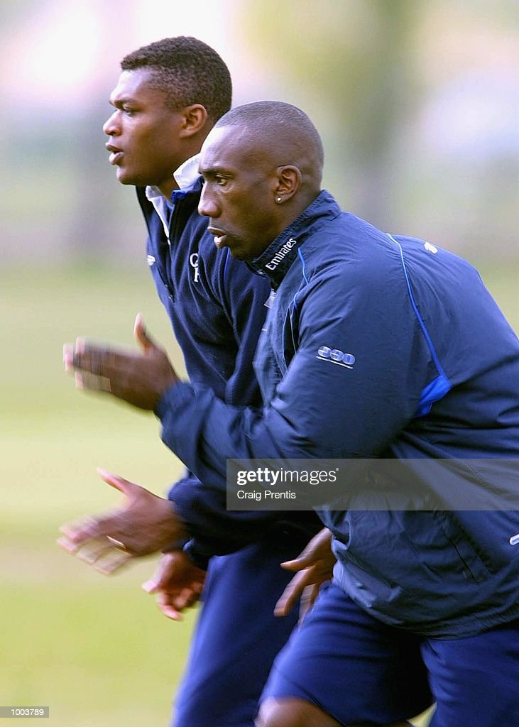 Jimmy Floyd Hasselbaink and Marcel Desailly of Chelsea during a training session at Chelsea's training ground near Heathrow in London, as the team prepare for Sunday's FA Cup semi-final match against Fulham at Villa Park. DIGITAL IMAGE Mandatory Credit: Craig Prentis/Getty Images